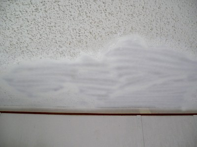 Loose popcorn texture removed from ceiling. - Acoustic Ceiling Texture Repair - The Practical House Painting Guide