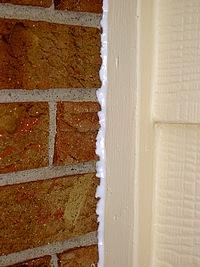 Use clear caulk on brick.