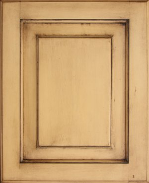 Cabinet door antiqued using wood stain over paint.