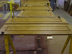 Refinishing kitchen cabinet doors.