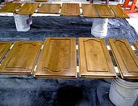 Refinishing kitchen cabinet doors.