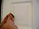 Brushing the beveled areas on doors.