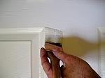 Brushing paint on door style.