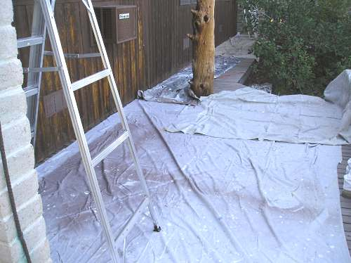 Drop cloths covering a wood deck.