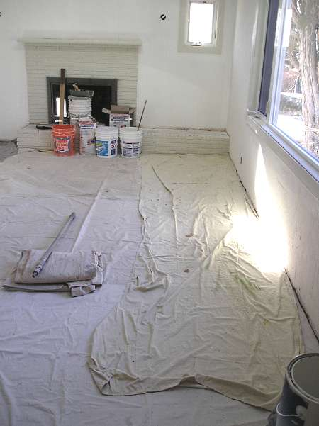 PVC backed dropcloths covering interior hardwood floor.