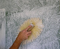 Using a drywall texture brush to stomp the texure.