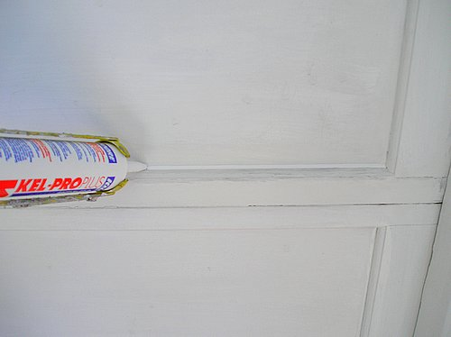Apply caulking to all four sides of the garage door panel.