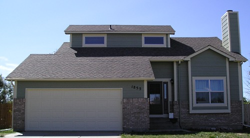 Large Home Painted With 3 Colors Tan Stucco Cream Trim And Black Accents When Painting The Exterior