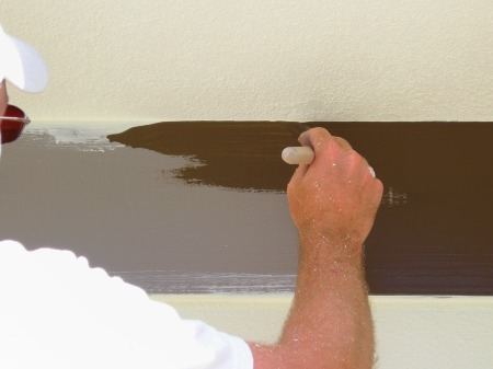 Brushing exterior trim.