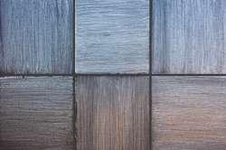 Faux painted tile using a glaze dragging technique.