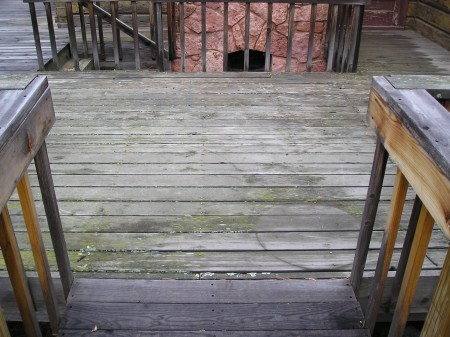 Old wood deck in desperate need of refinishing.