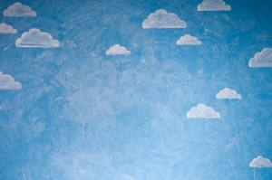 Modestly painted clouds on blue background.