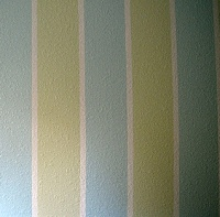 Multi-tone painted stripes on a wall.