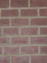Painted faux brick on a textured wall.