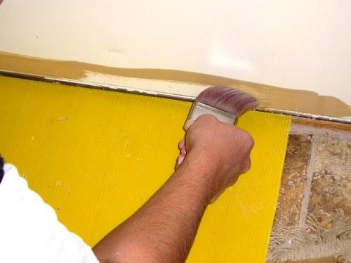 Cutting the bottom of a steel door.