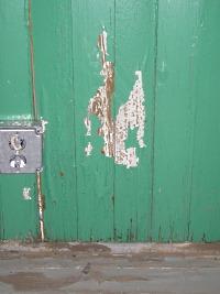 Peeling paint inside enclosed porch.