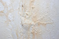 Peeling Paint On Interior Wall Caused By Water Damage