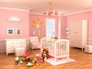 Nicely painted and decorated pink baby nursery.