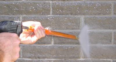 Using a pressure washer on masonry.