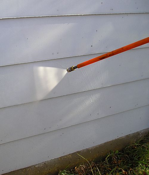 Pressure washing siding.