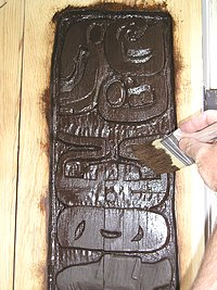 Applying Gel Stain to the carved areas.