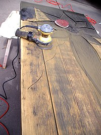 Removing the Previous Finish with a Power Sander.