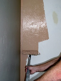 Painting walls with a roller.