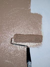 Overlap each stroke of the paint roller.