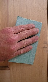 Remove blemishes before staining wood.