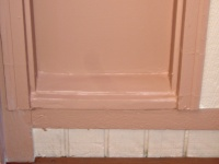 Rotted front door sidelight sill patched and painted.