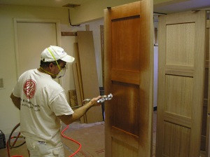 Spraying wood stain on doors using an HVLP sprayer. & Techniques for Staining Wood - The Practical House Painting Guide