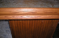 Stainied oak trim and bead board.
