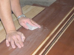 Using a sanding sponge between coats. Always lightly sand between each coat of clear wood finish.