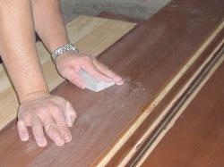 Using a sanding sponge between coats. Always lightly sand between each coat of clear wood finish.