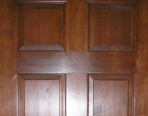 Solid wood door after refinishing.