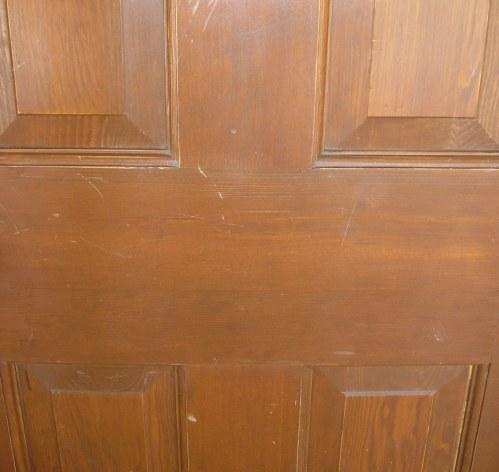 Solid wood door before refinishing.