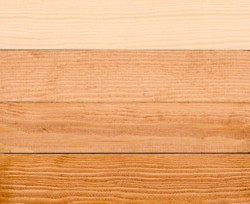 Stages of staining wood from raw-coat of stain-coat of finish.