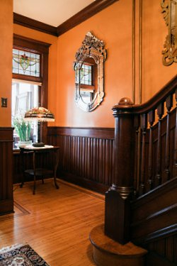 Interior Wood Stain Colors-Foyer with Wainscoting, Wooden Stairway in  Restored Ornate Victorian Home