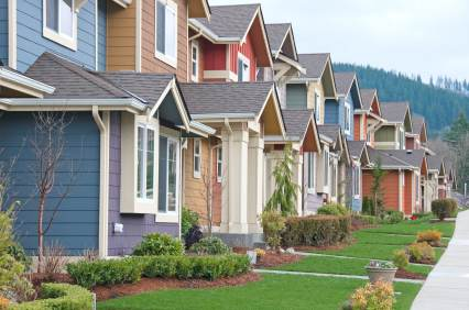 New houses in housing development in foothills of mountains.