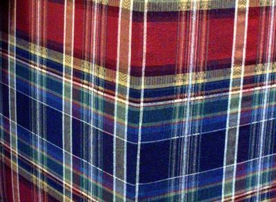 Plaid fabric on a sofa.