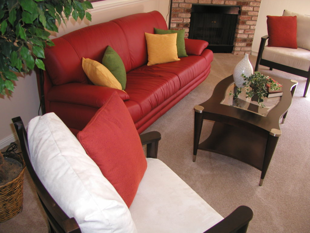 Colorful decor in a room with neutral paint colors.