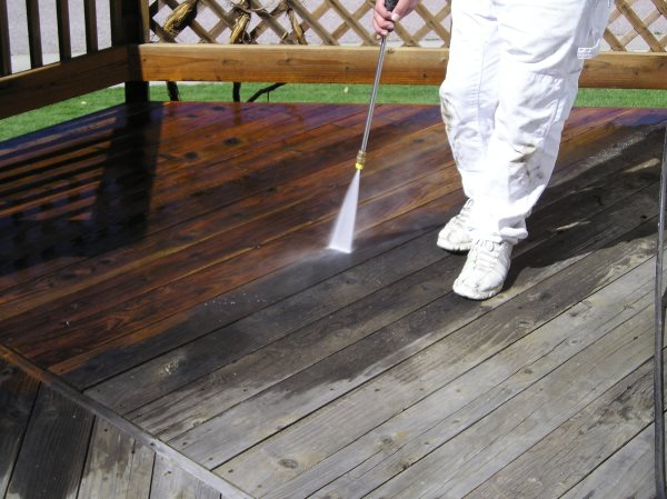 High pressure washing a deck before staining.