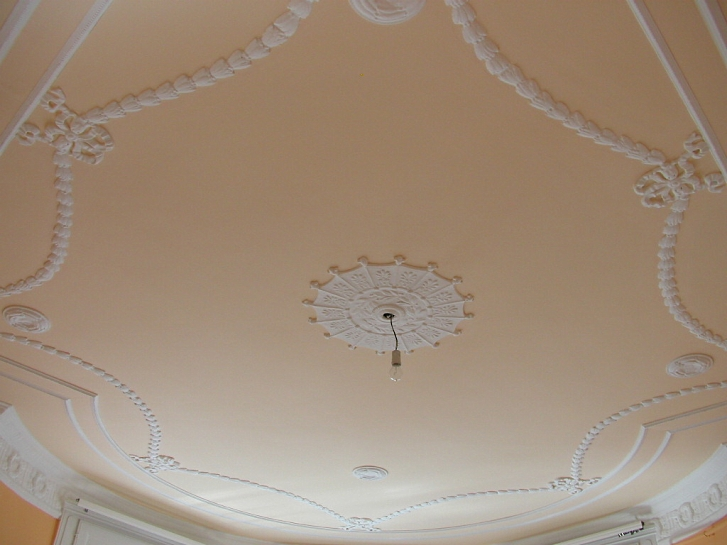 Fancy peach colored ceiling.