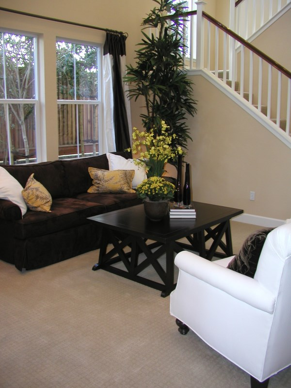 Living room painted with a nice neutral on the walls and white trim.