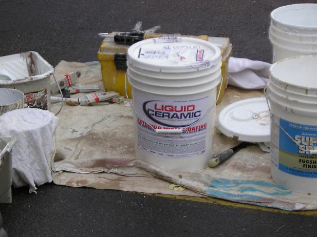 5 gallon paint bucket and assorted painting tools.