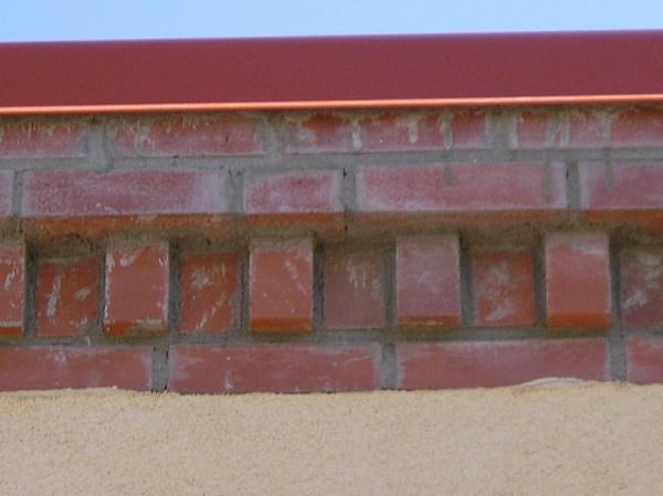 Painting new exterior brick.