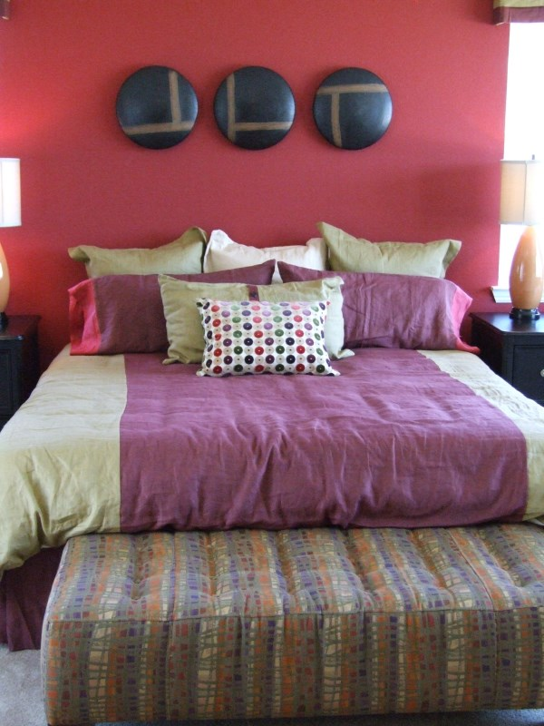 Red accent wall in master bedroom.