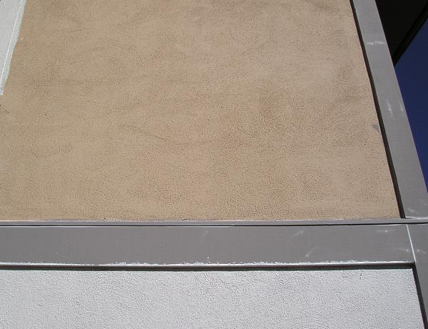 Smooth unpainted stucco.