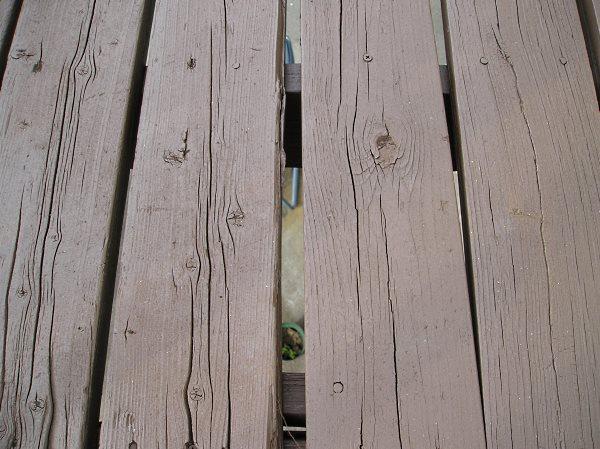 Old split rotten deck floor boards.