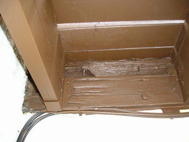 Split and rotted deck sill board.